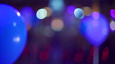 biesiada : blurred helium balloons and colorful spotlights as party decoration