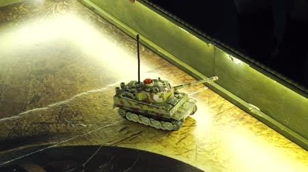 harcias : scale model miltary tank with camouflage moving on play board