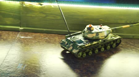 remotely : remote control miniature tank with camuflage moving on play board Stock Footage