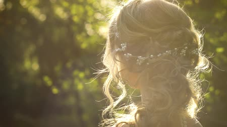 ティアラ : back view of bride with hair wreath in sunny garden with free space