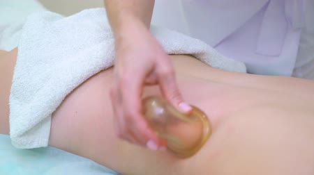 massager : closeup of vacuum anti cellulite massage on woman back