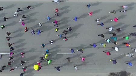 run down : top down aerial shot of marathon runners on asphalt road Stock Footage