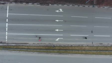 run down : top down aerial shot of group of people running marathon on empty road
