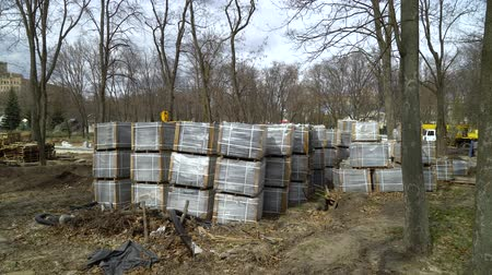 godo : lots of paving stones stacks are stored on ground on construction site