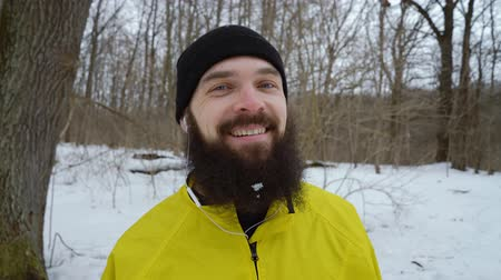 bigode : closeup portrait of bearded man with blue eyes laughing in winter forest Stock Footage