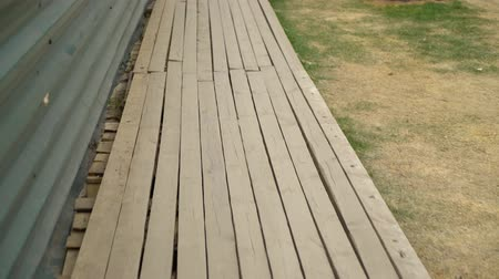 rebuild : wooden deck near metal fence at renovation site