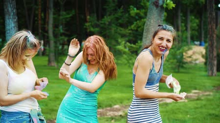 ziyafet : three female friends have fun at Holi colors festival in summer park