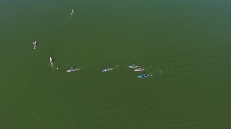 sucção : aerial top down of athletes at stand up paddle competition bypassing buoy