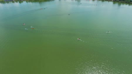 boa : aerial of water sports competition with kayakers and stand up paddle boarders