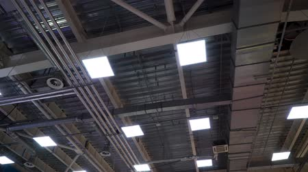 çinko : air duct ventilation pipes on ceiling of big industrial building Stok Video