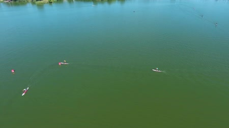 boa : aerial of SUP paddleboarders bypass buoy on green river