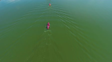 two seater : aerial of athletes in kayaks paddling during water competition