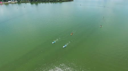 sucção : aerial of water festival with kayakers and SUP boarders on green river in summer