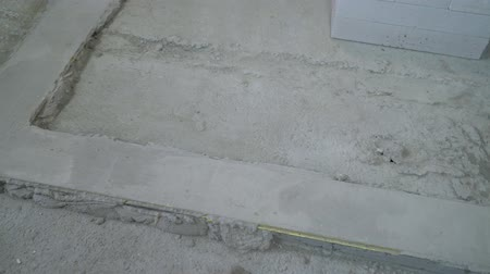 aerated : pan shot of concrete foundation ready for laying a new brick wall