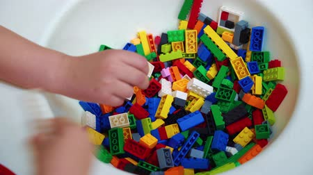 교육적인 : closeup of small plastic blocks being taken by hands of kindergarten children 무비클립