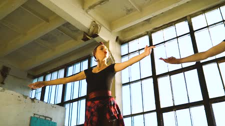 femininity : low angle shot of dancers warming up in loft studio with pigeon flying inside Stock Footage