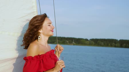 tasting : Beautiful woman relaxing on sailing boat