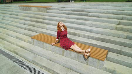 plezant : Happy red haired girl enjoying warm weather in park