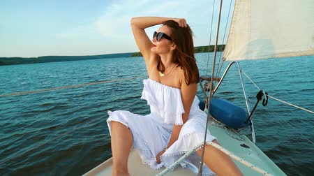 voyager : Happy voyager enjoying trip on sailing boat on sunny day