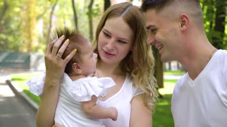 davidster : Happy Jewish family with baby daughter in summer park