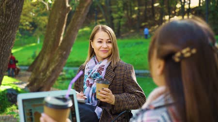 jovial : Fellow students studying in autumn park