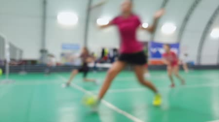 badmington : Blurred kids training with rackets on badminton court