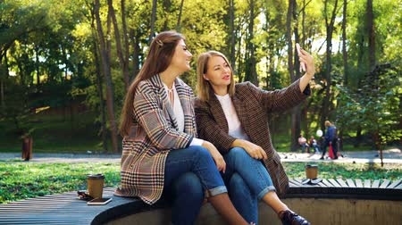 follower : Beautiful bloggers live streaming using smartphone in public park