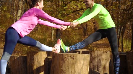 пьедестал : Athletic couple holding hands and training together in autumn forest