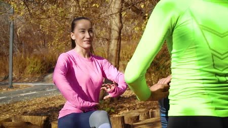 Smiling girl training with partner in autumn park Stock Footage