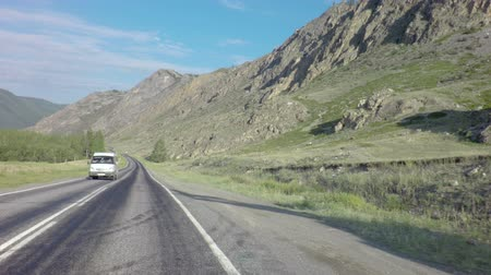 ridge line : Travel by car on the Chuysky Trakt in Altai Mountains. Stock Footage