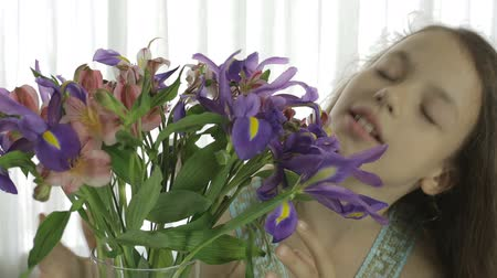 alstroemeria : Beautiful girl enjoys bestowed a bouquet of flowers.