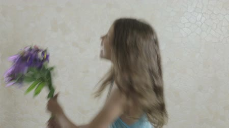 alstroemeria : Beautiful girl rejoices donated a bouquet of flowers and swirls. Stock Footage