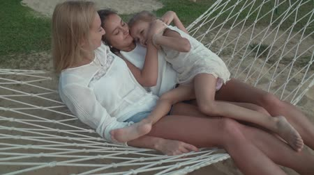 megölel : Happy family rides emotionally on a hammock stock footage video