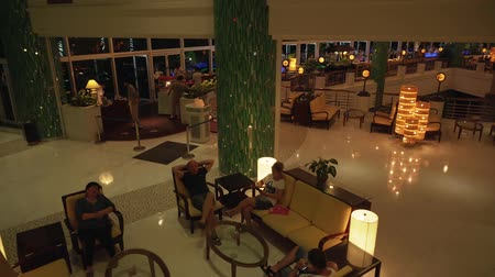 устанавливать : Sanya, China - April 04, 2017: Cozy lobby with evening lighting at the hotel Resort Intime Sanya 5 in Dadonghai bay Стоковые видеозаписи