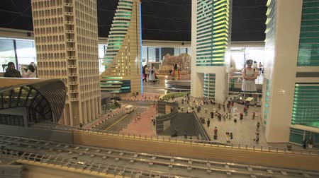 lego : Dubai, UAE - April 01, 2018: Exhibition of mock-ups Dubai subway near skyscrapers made of Lego pieces in Miniland Legoland at Dubai Parks and Resorts stock footage video Stock Footage