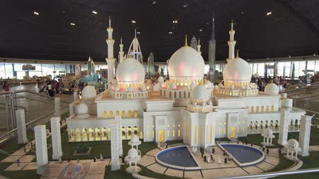 lego : Dubai, UAE - April 01, 2018: Exhibition of mock-ups Sheikh Zayed Grand Mosque made of Lego pieces in Miniland Legoland at Dubai Parks and Resorts stock footage video