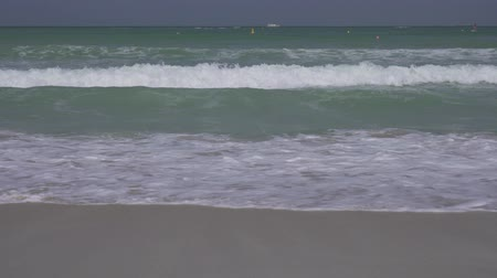 niebieski : Beautiful large sea waves of the Persian Gulf on the public Jumeirah Open Beach in Dubai stock footage video