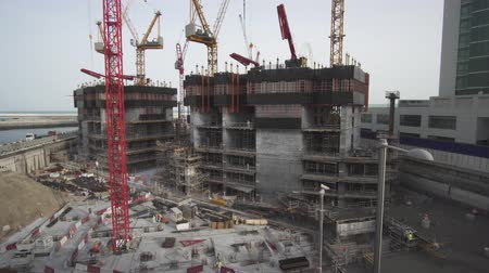 architectural protection : Dubai, UAE - April 01, 2018: Grandiose construction on the waterfront of Dubai Marina stock footage video