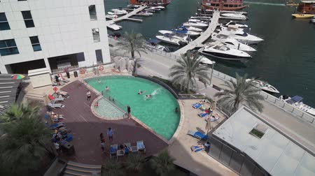 cayan tower : Dubai, UAE - April 02, 2018: Pool at the Lotus Hotel Apartments in Dubai Marina stock footage video