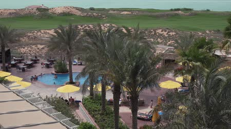 corniche : Abu Dhabi, UAE - April 03, 2018: Area of hotel Park Inn by Radisson Abu Dhabi Yas Island stock footage video Stock Footage