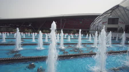 roadster : Abu Dhabi, UAE - April 04, 2018: Fountain in the restaurant zone of the Ferrari World Abu Dhabi stock footage video Stock Footage