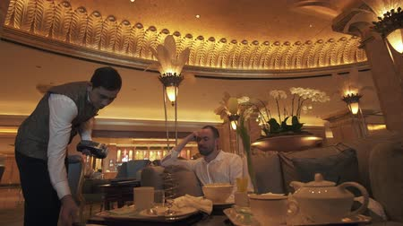 palmtree : Abu Dhabi, UAE - April 04, 2018: Interior of Presidential Hotel Emirates Palace in Abu Dhabi stock footage video Stock Footage