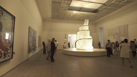 laminált : Abu Dhabi, UAE - April 04, 2018: People looking at exhibits in the new Louvre Museum in Abu Dhabi stock footage video