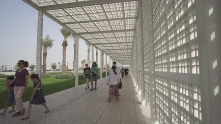 laminált : Abu Dhabi, UAE - April 04, 2018: Territory of the new museum Louvre in Abu Dhabi stock footage video