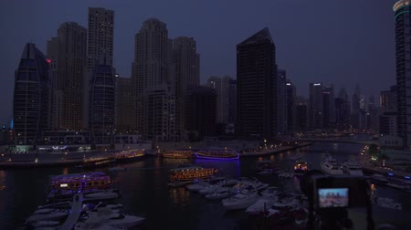 cayan tower : Dubai, UAE - April 02, 2018: Camera shoots taymlaps night view of Dubai Marina stock footage video