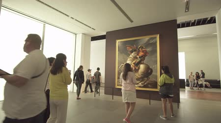 музей : Abu Dhabi, UAE - April 04, 2018: People looking at exhibits in the new Louvre Museum in Abu Dhabi stock footage video