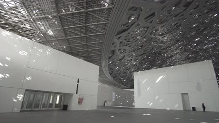 laminált : Abu Dhabi, UAE - April 04, 2018: Interior of the new Louvre Museum in Abu Dhabi showing reflections of the Rain of Light dome stock footage video