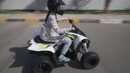 atv : Girl teenager rides on the ATV on the road
