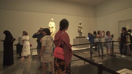 dark island : Abu Dhabi, UAE - April 04, 2018: People looking at exhibits in the new Louvre Museum in Abu Dhabi stock footage video