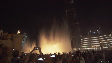 khalifa : Dubai, UAE - April 08, 2018: Dubai Fountain is the worlds largest choreographed fountain system on the Burj Khalifa Lake at night stock footage video Stock Footage